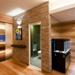 A frosted glass door to the bedroom provides light to the entry vestibule
