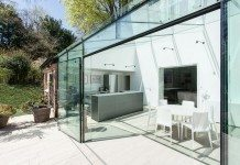 A glass extension rejuvenates a traditional brick home in Hampshire UK