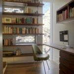 The four-story library adds to the home's privacy while adding functionality.