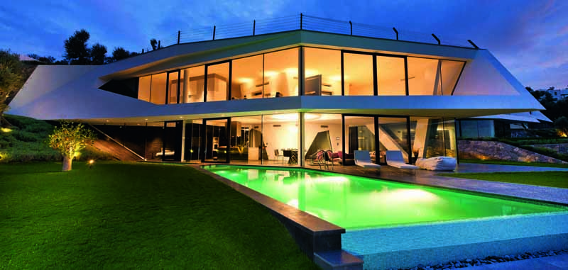 Bright colored pool lights this house up as the skies begin to dim.