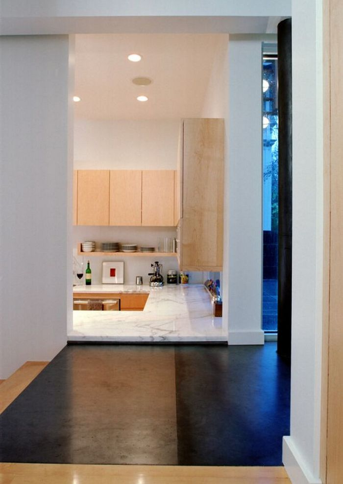 "An interesting use of levels creates a ""window"" to the kitchen in the Madrona Residence"