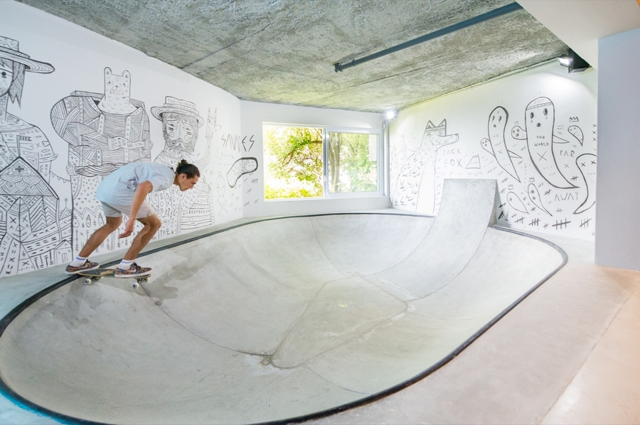 The ultimate man cave featuring a skate bowl!