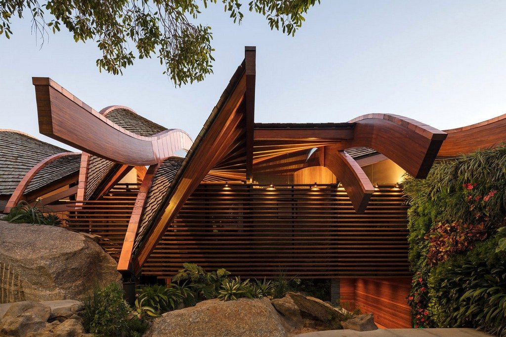 Undulating roofs mimic the waves.