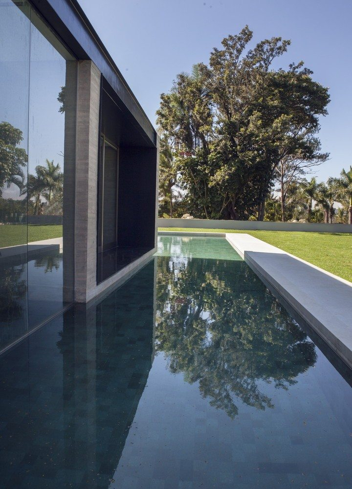 In addition the strong visual effect, the water helps to keep the house cool.