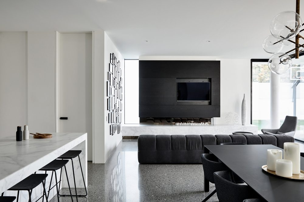 Black furnishings provide a much-needed contrast against the white walls.