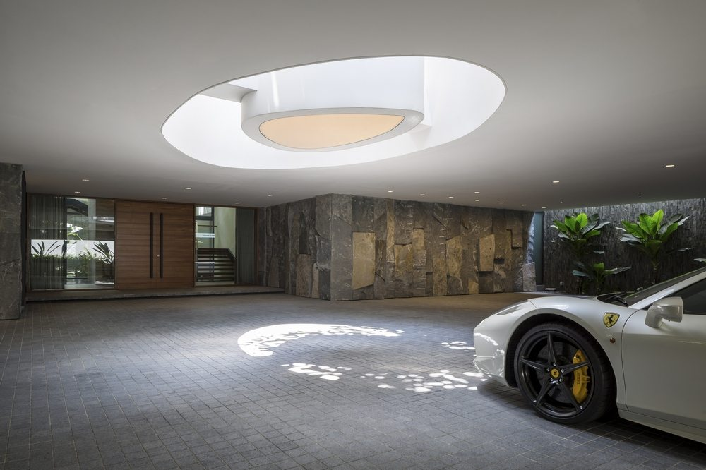 A six-car garage sits below the large swimming pool, complete with a huge skylight.