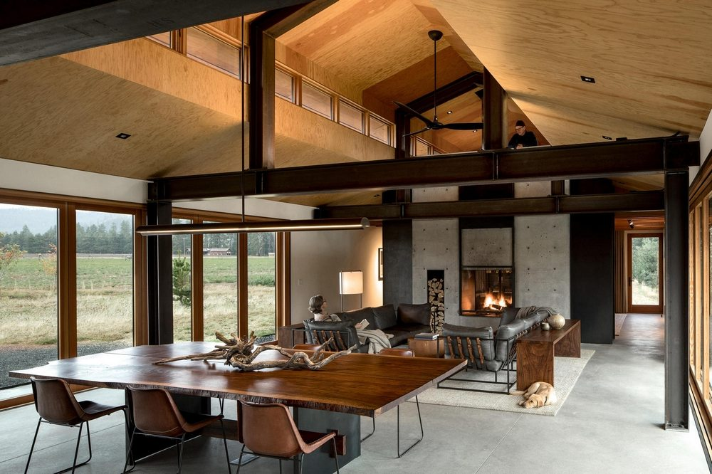 Modern and luxurious interiors contrast with the rustic-looking facade of the house.