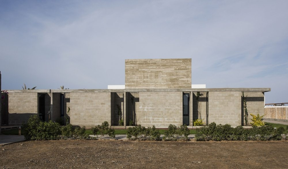Exposed concrete allows the house to blend in with the Peruvian desert landscape.