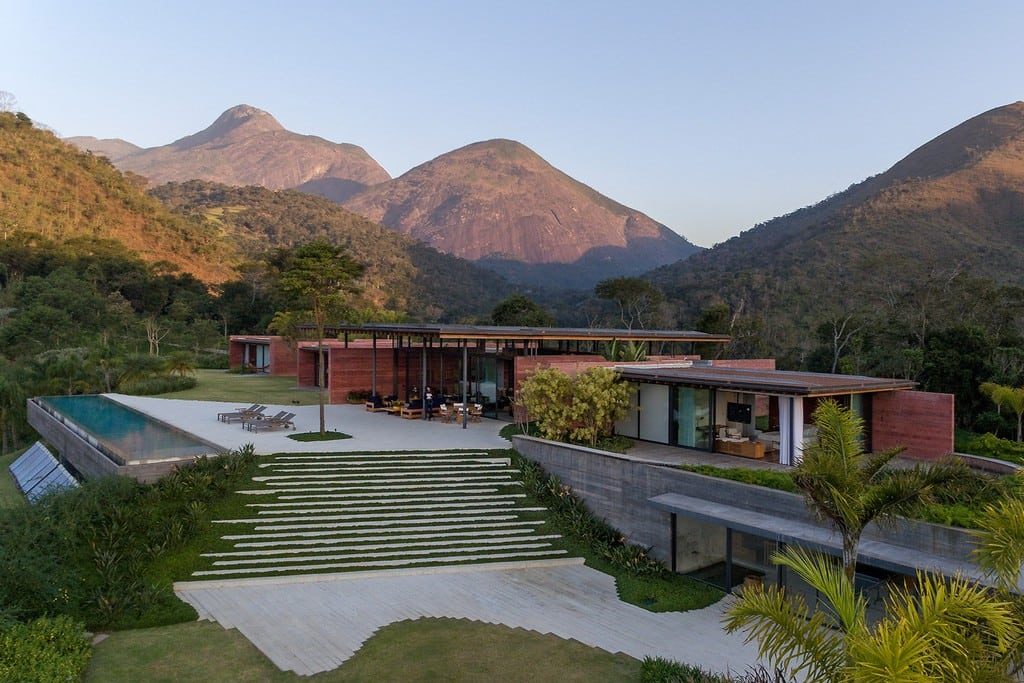 Casa Terra's pigmented concrete walls blend with the surrounding landscape.