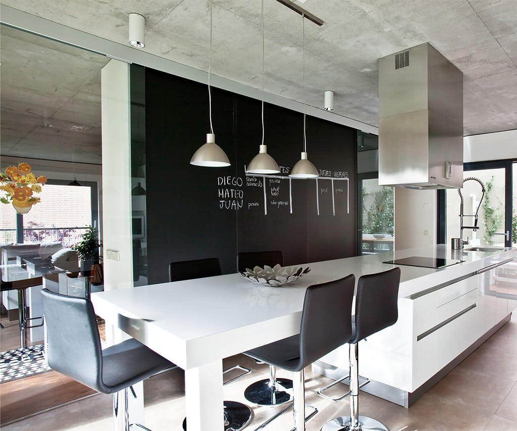 The common areas include the kitchen, dining area, and the sitting room.