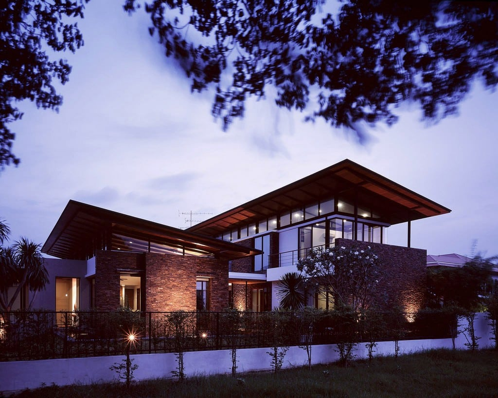 The facade is made from a combination of timber and rock with a natural finish.