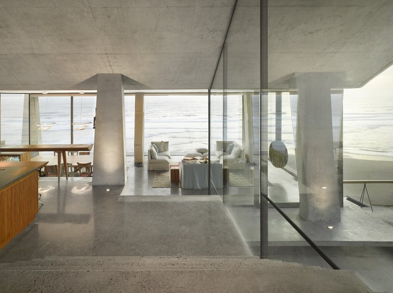 Large glass windows provide unrestricted views of the Pacific Ocean.