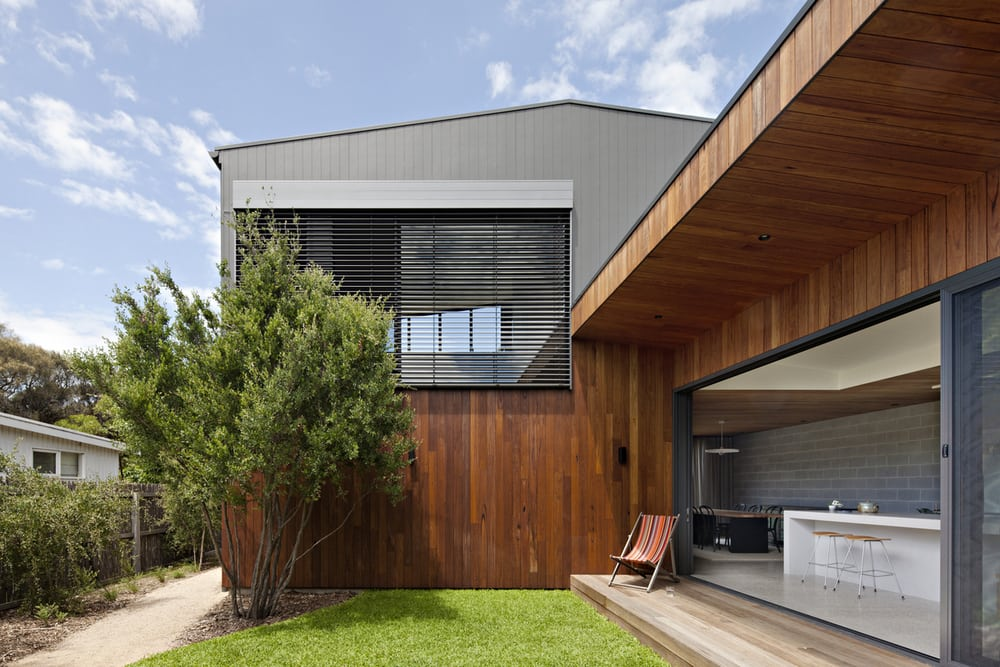 Timber panels are found in the home's exteriors and interiors.