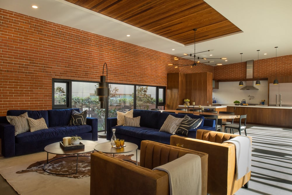 The dining room, kitchen, and living room are all connected to a large outdoor patio.