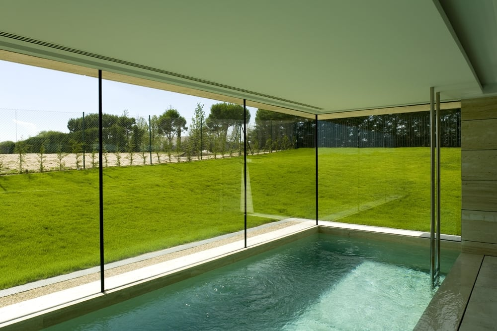 Large glass windows provide unrestricted views of the greenery outside.