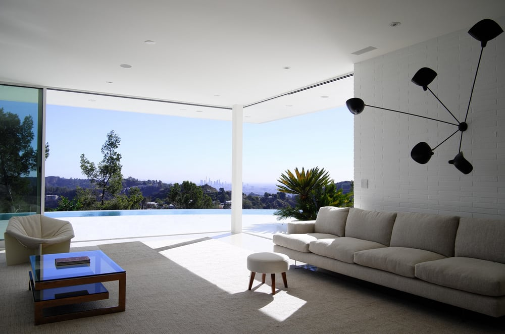 A new addition to the home, this living room opens up to the outdoor terrace.