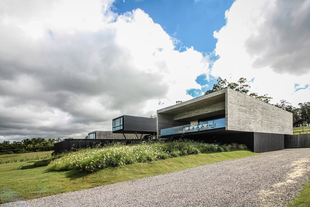 Two of the pavilions are made of untreated concrete, creating a striking appearance.