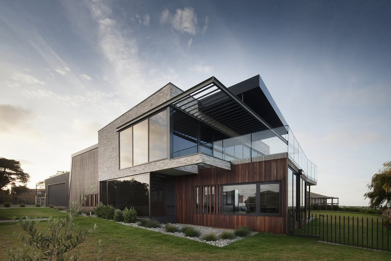 The house is clad in timber designed to age gracefully over time.