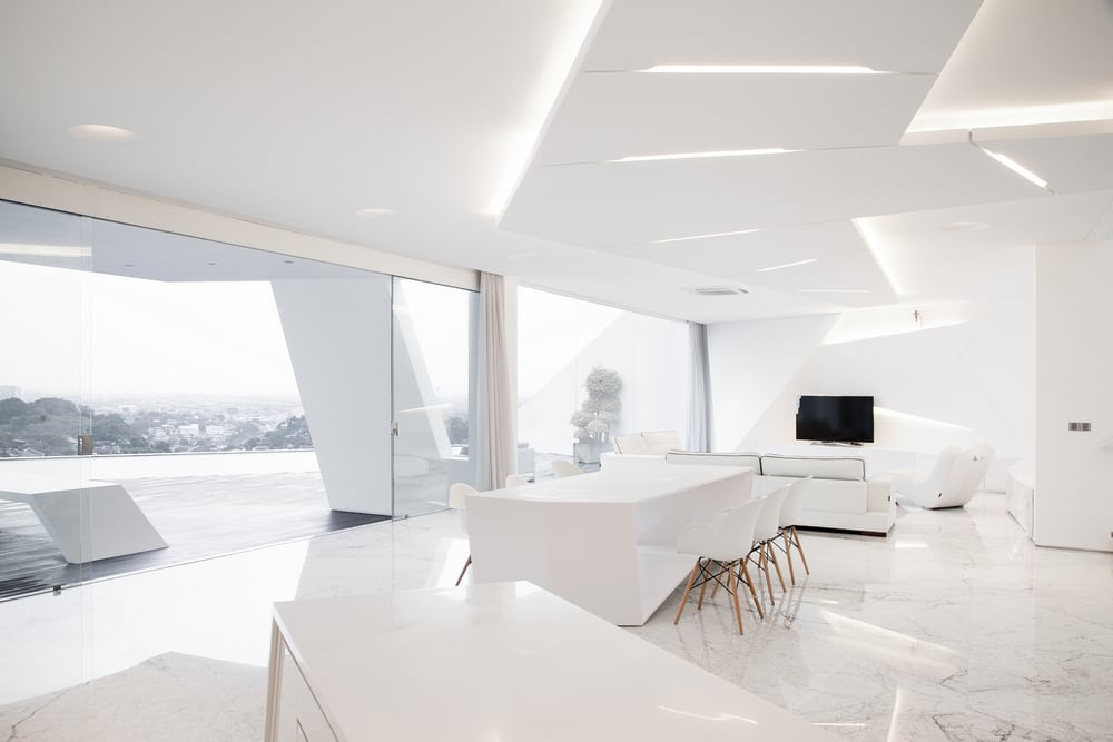 The interior features stark white walls, ceiling, and furnishings.