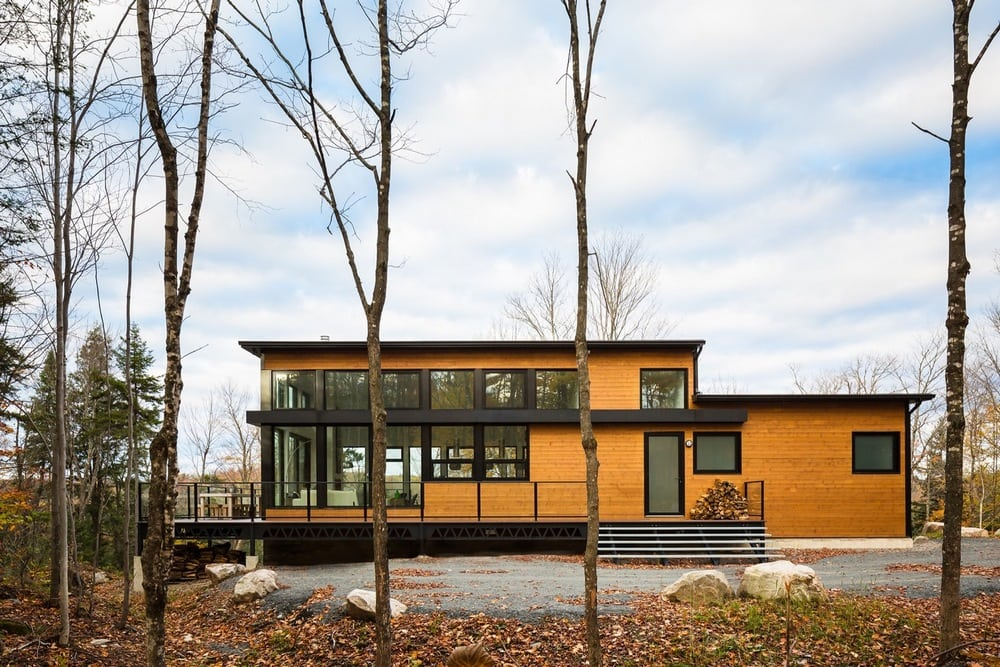 The home's exterior uses a power combo of timber and metal.