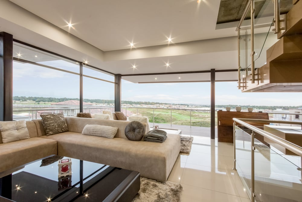 Floor-to-ceiling windows allow the inhabitants unrestricted views of the surrounding landscape.