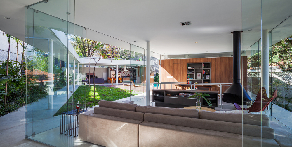 An open-plan kitchen, living, and dining space flows into the outdoor area.