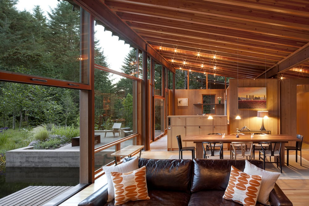 Large glass walls on one side of the house allow unrestricted views of the picturesque landscape.