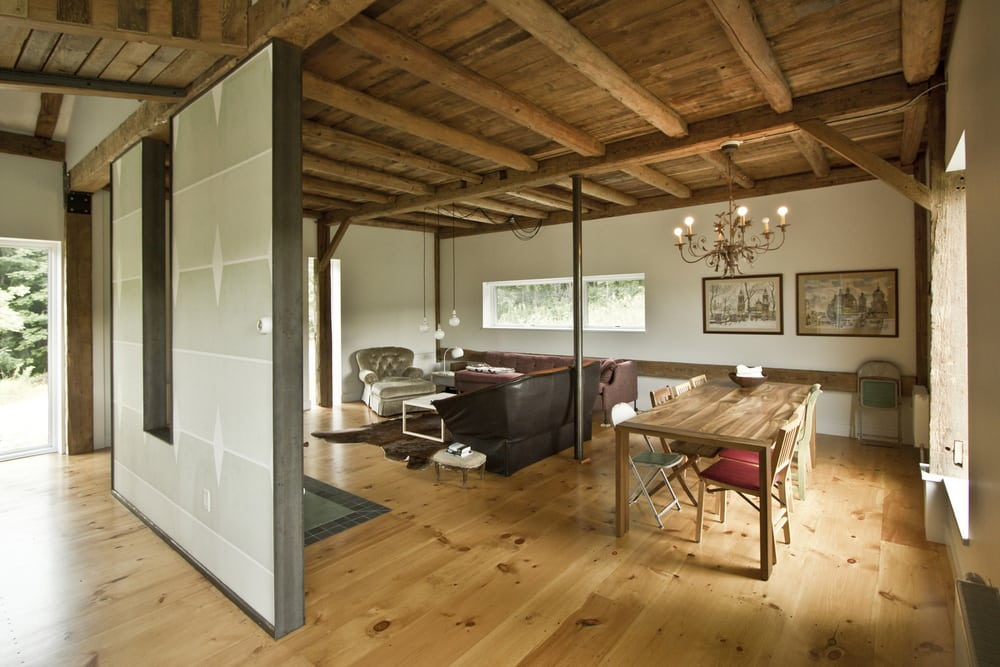 Exposed timber ceiling and floors make the interiors feel warm and comfortable.