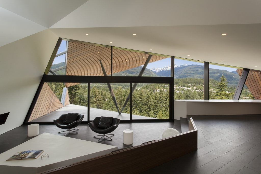 Large glass windows frame outdoor views of breathtaking scenery.