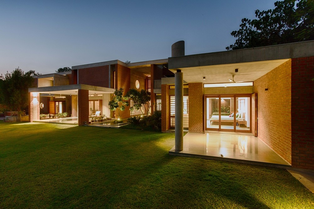 Shaila Patel House is made of natural red bricks, common in Indian architecture.