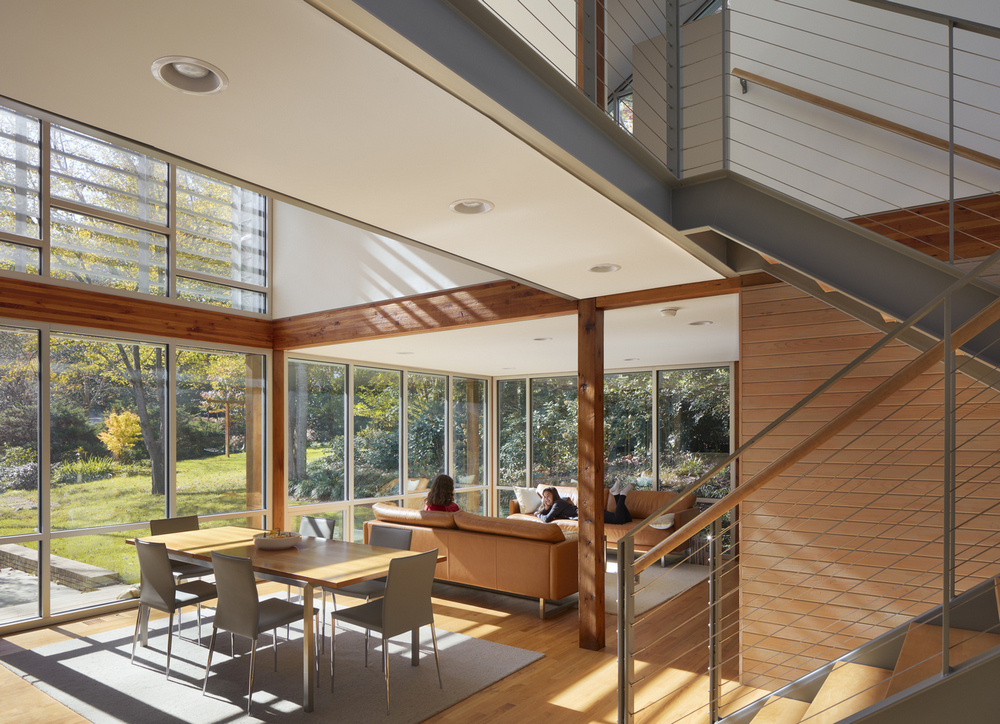 Floor-to-ceiling windows allow plenty of natural light into the house.