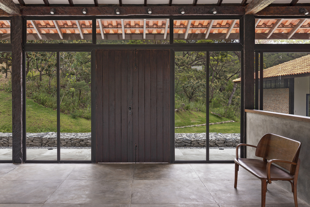 Glass panels allows an indoor-outdoor living experience.