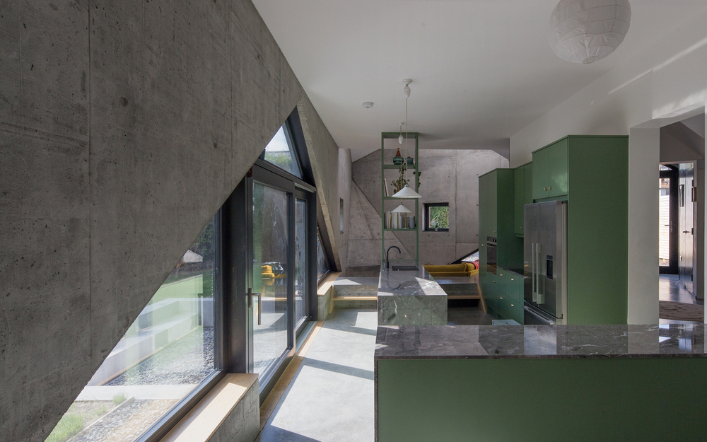 Exposed reinforced concrete is seen all throughout the house.